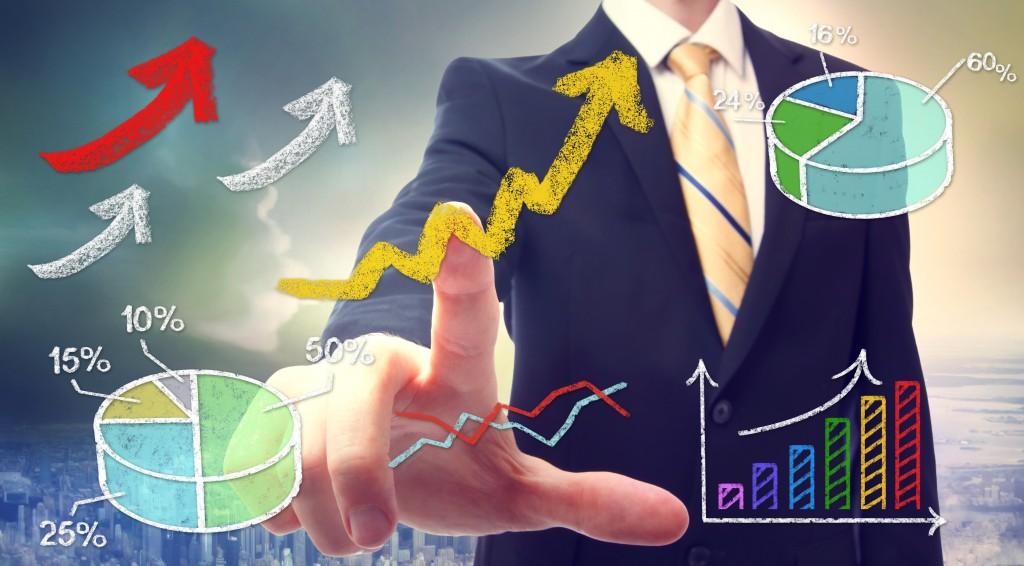 Businessman pointing at rising arrows